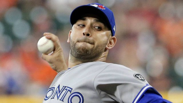 Toronto-Blue-Jays-starting-pitcher-Marco-Estrada-(25)-throws-against-the-Houston-Astros-during-the-first-inning-of-a-baseball-game-Wednesday,-June-27,-2018,-in-Houston.-(Michael-Wyke/AP)