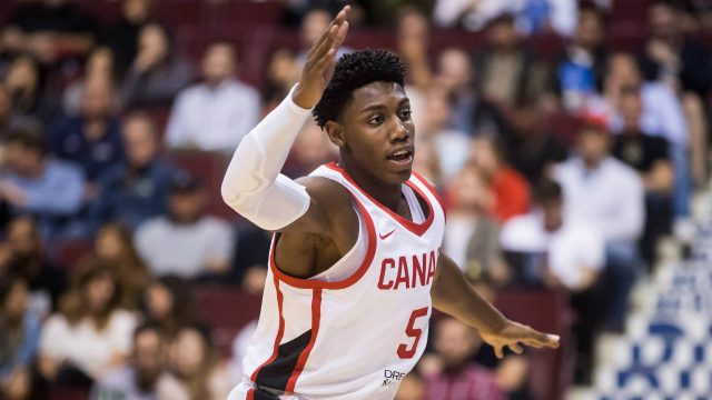 Canada's-R.J.-Barrett-defends-during-second-half-Pacific-Rim-Basketball-Classic-action.