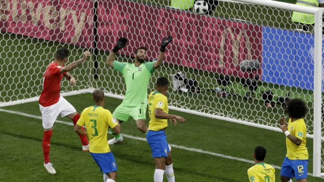 Switzerland's-Steven-Zuber,-left,-scores-his-side's-first-goal-during-the-group-E-match-between-Brazil-and-Switzerland-at-the-2018-soccer-World-Cup-in-the-Rostov-Arena-in-Rostov-on-Don,-Russia,-Sunday,-June-17,-2018.-(Andrew-Medichini/AP)