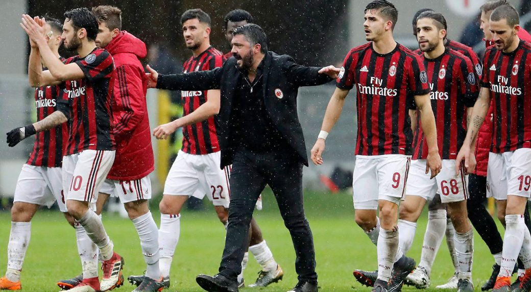 Soccer-AC-Milan-celebrating-win-in-Seria-A