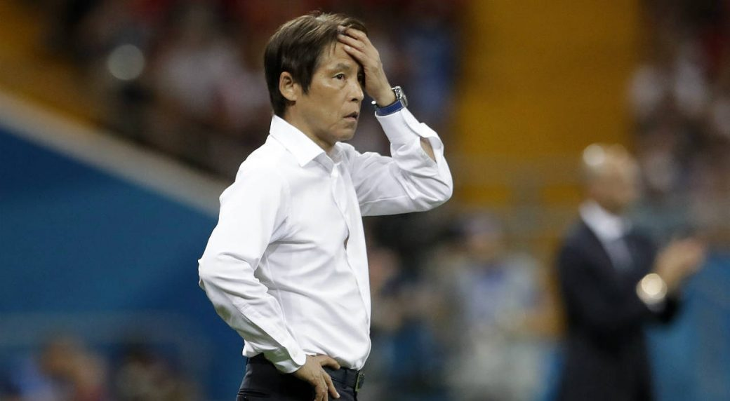 Japan's-head-coach-Akira-Nishino-reacts-in-his-coaching-zone-during-the-round-of-16-match-between-Belgium-and-Japan-at-the-2018-soccer-World-Cup-in-the-Rostov-Arena,-in-Rostov-on-Don,-Russia,-Monday,-July-2,-2018.