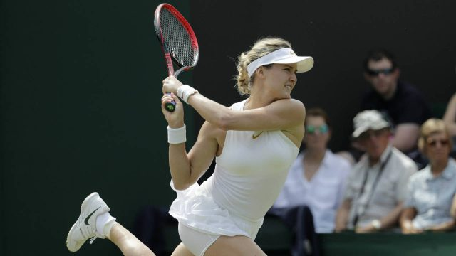 Eugenie-Bouchard-of-Canada-returns-a-ball-to-Ashleigh-Barty-of-Australia-during-their-women's-singles-match-on-the-fourth-day-at-the-Wimbledon-Tennis-Championships-in-London,-Thursday-July-5,-2018.