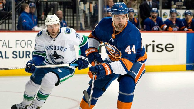 islanders-calvin-de-haan-move-the-puck-against-vancouver-canucks