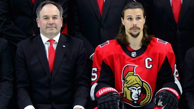 pierre-dorion-sits-beside-erik-karlsson-during-ottawa-senators-team-photo