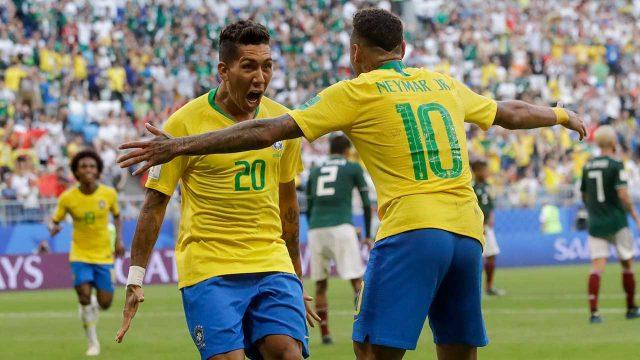roberto-firmino-celebrates-a-brazil-world-cup-goal-with-neymar