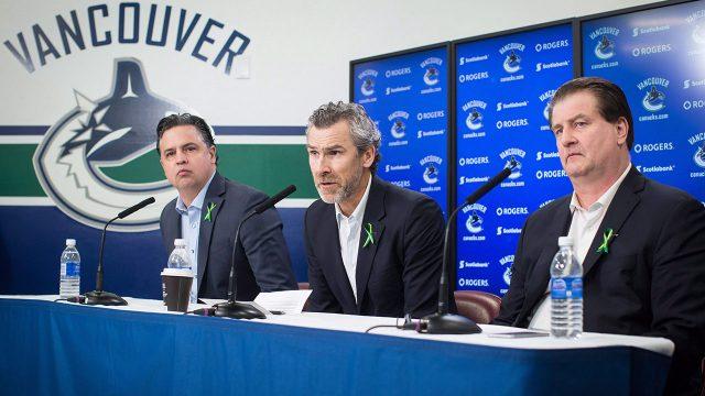 travis-green-trevor-linden-jim-benning-at-canucks-press-conference