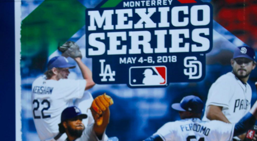 MLB-fan-posing-infront-of-Mexico-series-sign