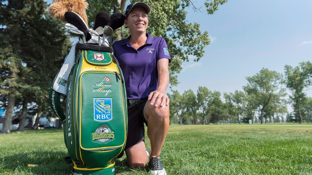 alena-sharp-poses-with-golf-bag-at-cp-womens-open