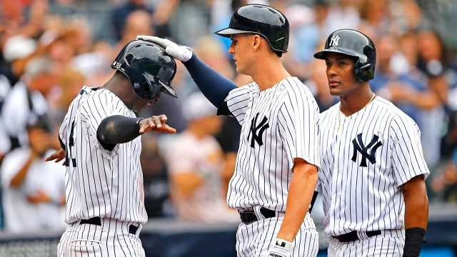 didi_gregorius_and_miguel_andujar_celebrate_with_greg_bird