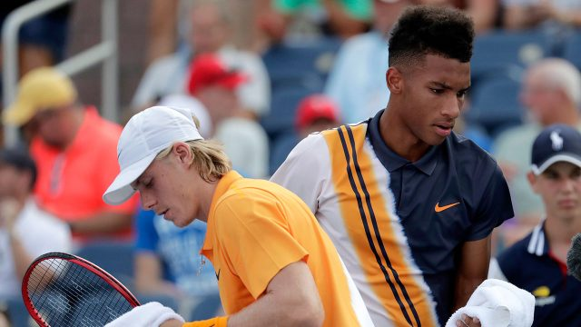 felix-auger-aliassime-and-denis-shapovalov-pass-each-other
