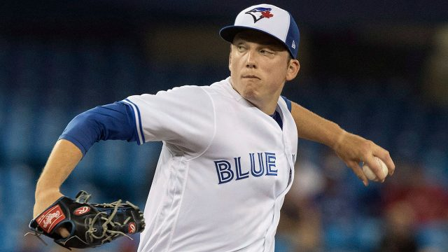 ryan_borucki_throws_a_pitch_against_boston