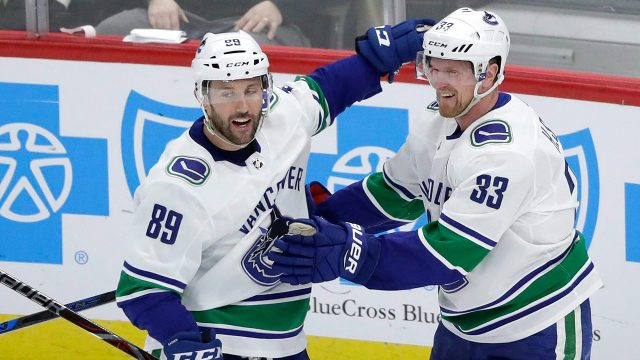 sam-gagner-celebrates-goal-with-canucks-teammate-henrik-sedin