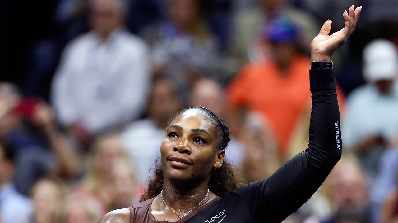 serena_williams_waves_after_a_win_over_sister_venus