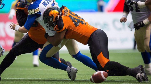CFL-Lions-Forde-tackles-Bombers-player