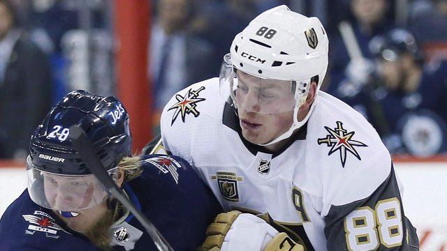 NHL-Knights-Nate-Schmidt-hitting-Jets-Laine