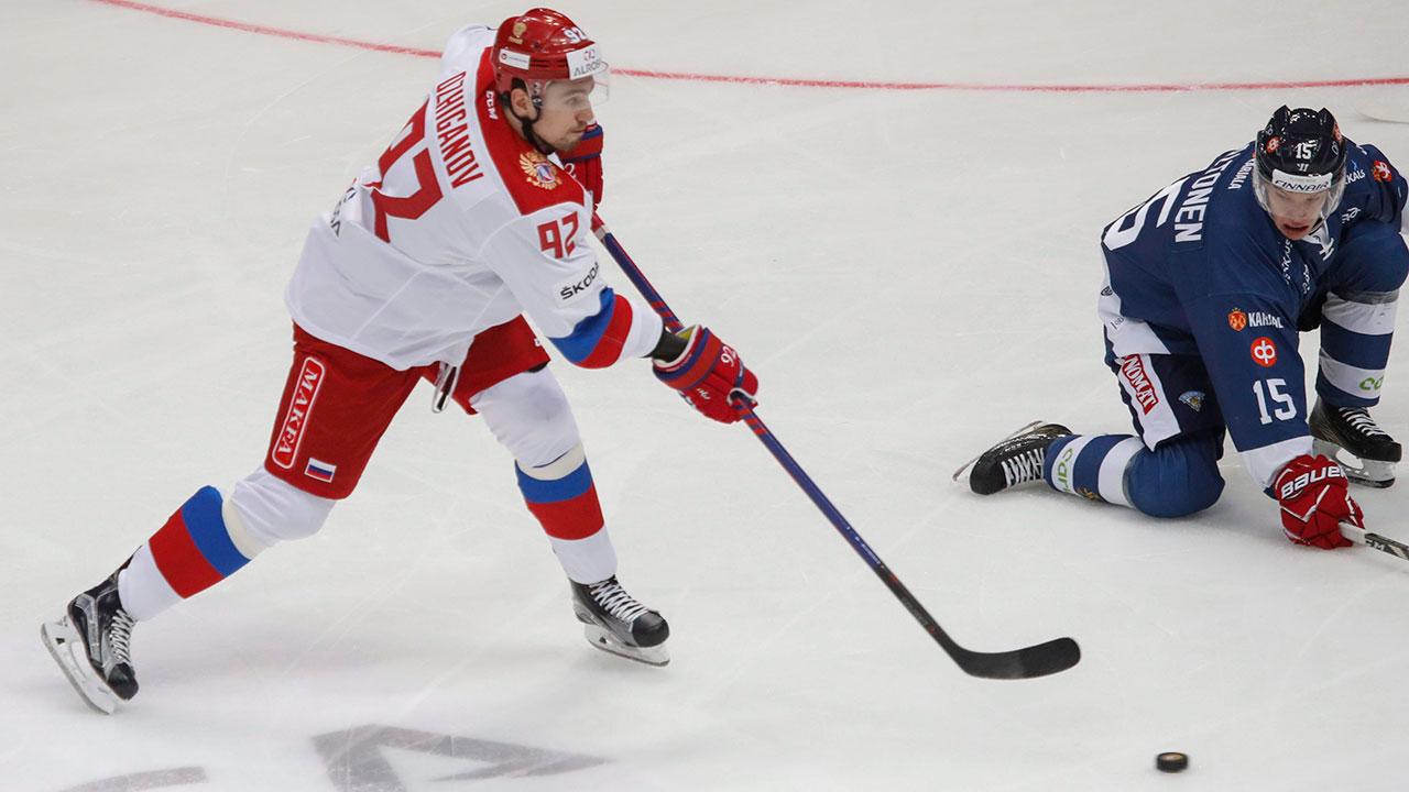 NHL-Russia-Ozhiganov-shoots-puck