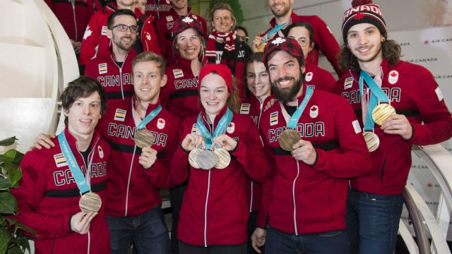Members-of-team-Canada-show-off-their-2018-Pyeongchang-Winter-Olympic-medals-on-their-arrival-back-from-the-games-at-Trudeau-airport-in-Montreal,-Monday,-February-26,-2018.