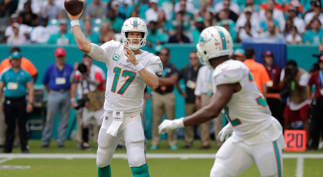 dolphins-quarterback-ryan-tannehill-throws-to-kenyan-drake