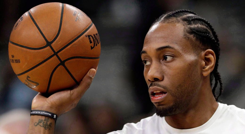 kawhi_leonard_handles_a_basketball_before_a_game
