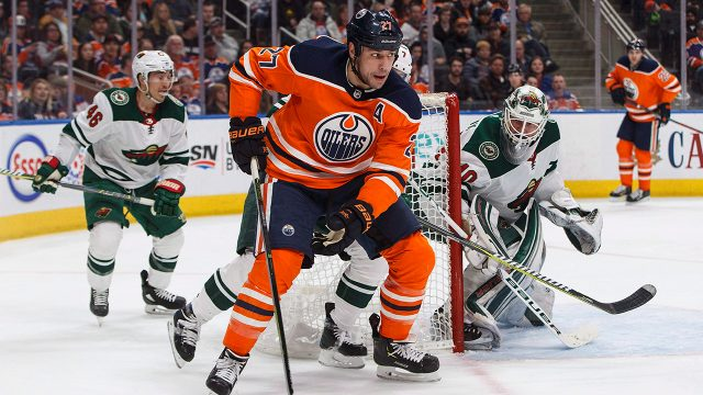 oilers-milan-lucic-takes-puck-around-wild-net