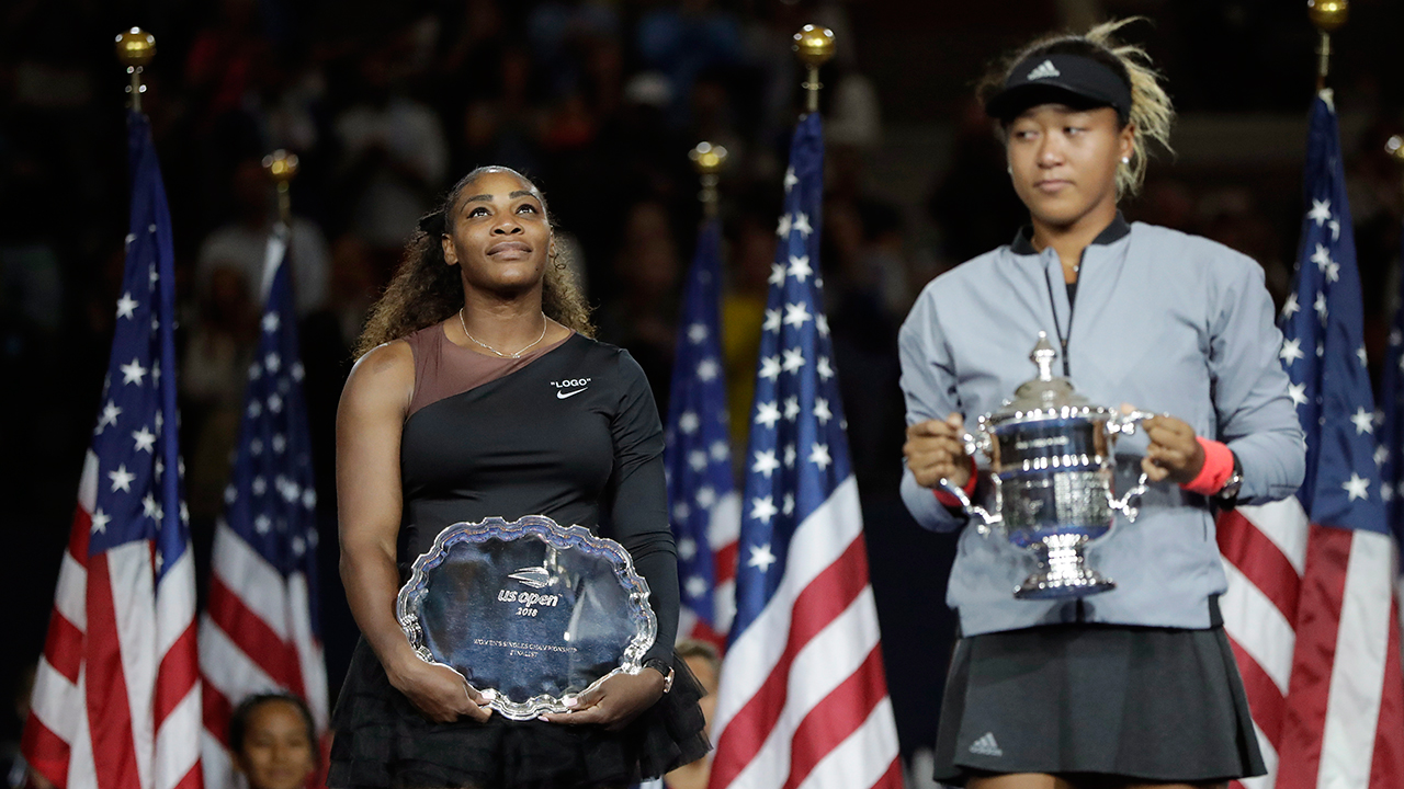 serena-williams-watches-as-naomi-osaka-holds-us-open-trophy