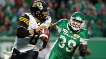 CFL-Roughriders-Hughes-chases-Tigercats-Masoli