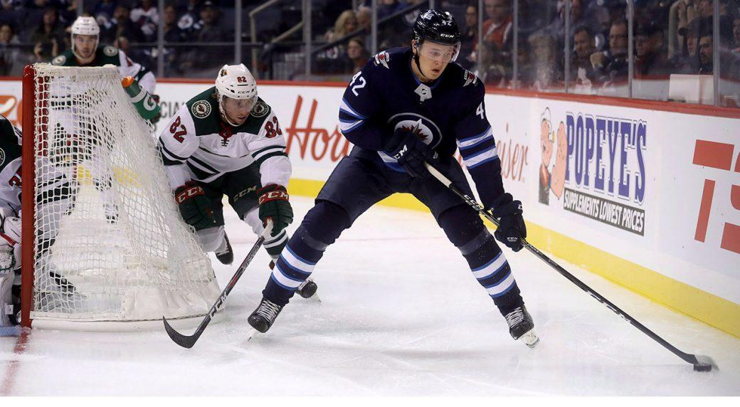 NHL-Jets-Vesalainen-skating-against-Wild