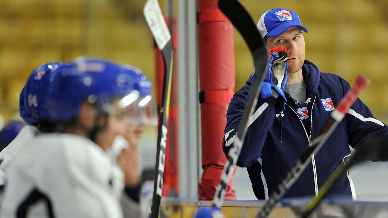 Kitchener-Rangers-assistant-coach-Dennis-Wideman-talks-to-players-during-practice