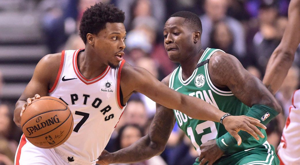 kyle_lowry_looks_to_dribble_past_terry_rozier