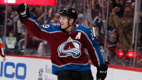 Colorado-Avalanche-center-Nathan-MacKinnon-celebrates-after-scoring-a-goal-against-the-Ottawa-Senator.-(David-Zalubowski/AP)