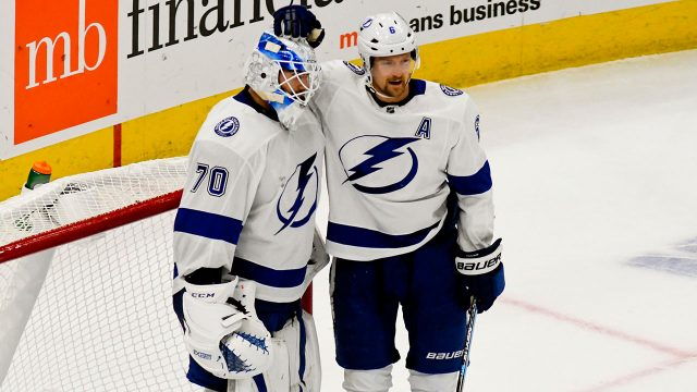 louis_domingue_and_anton_stralman_celebrate_a_win