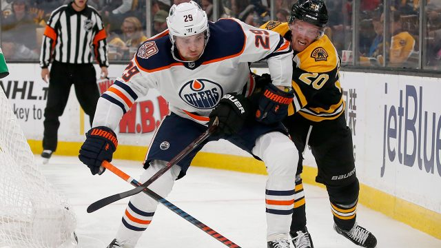 oilers-leon-draisaitl-looks-to-clear-puck-against-bruins