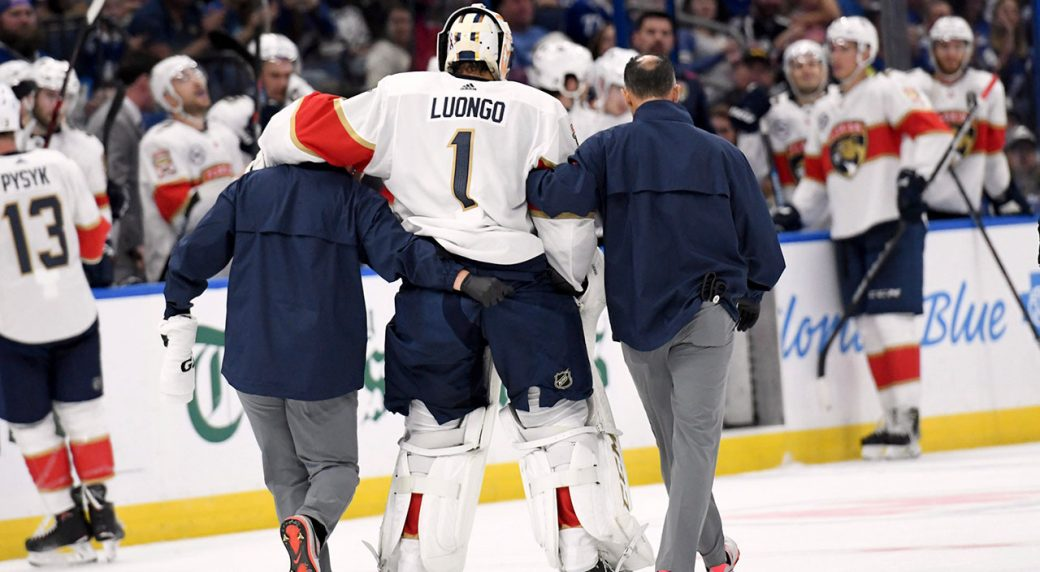 roberto_luongo_is_helped_off_the_ice