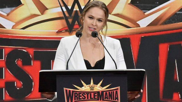 ronda-rousey-stands-at-wwe-wrestlemania-podium