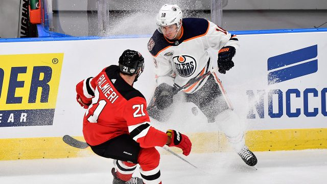 ryan_strome_battles_for_the_puck_with_kyle_palmieri