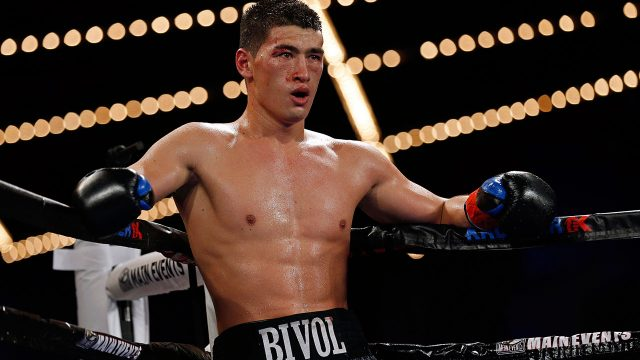 Dmitry-Bivol-stands-in-ring-during-WBA-title-boxing-match-on-HBO