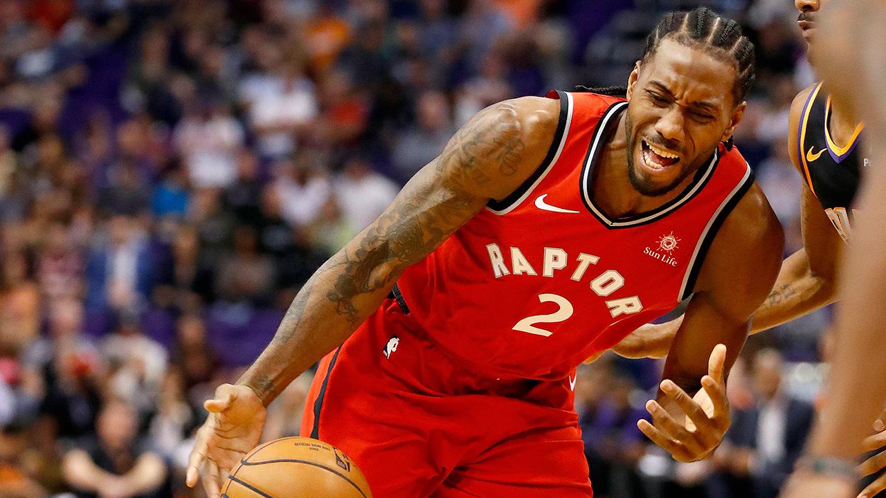 NBA-Raptors-Kawhi-Leonard-drives-against-the-Suns