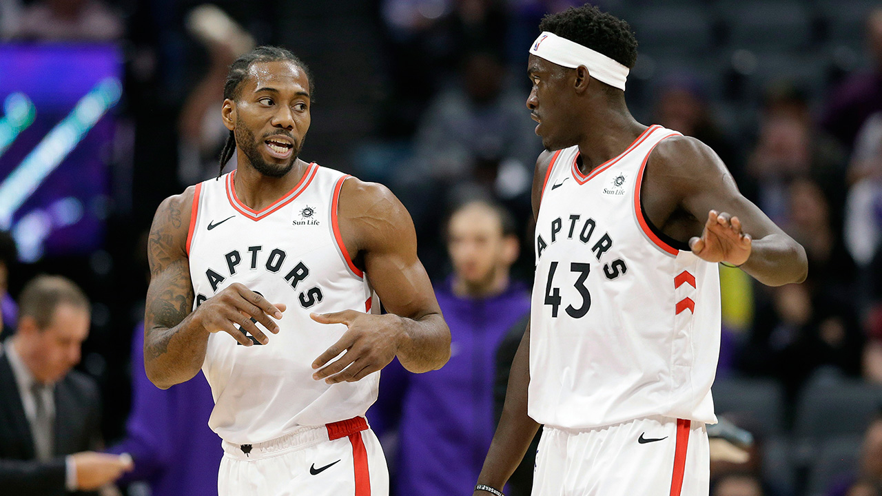 NBA-Raptors-Siakam-and-Leonard-during-game-against-Kings