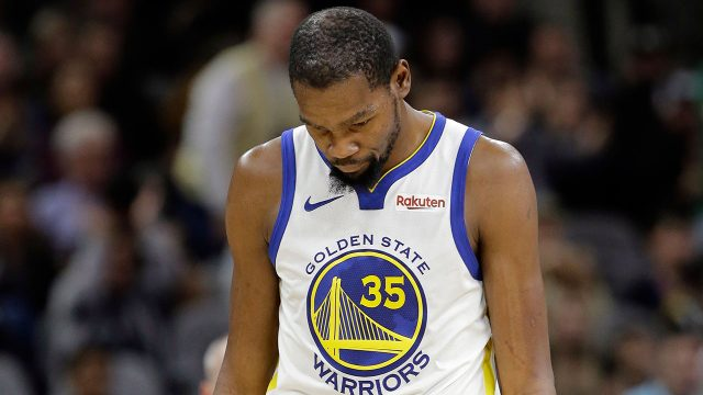NBA-Warriors-Durant-walks-down-court-after-play