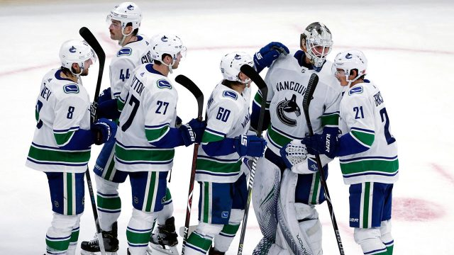 jacob-markstrom-celebrates-a-win-with-teammates
