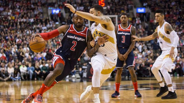 john-wall-drives-at-fred-van-vleet