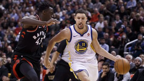Golden-State-Warriors-guard-Klay-Thompson-drives-against-Toronto-Raptors-forward-Pascal-Siakam