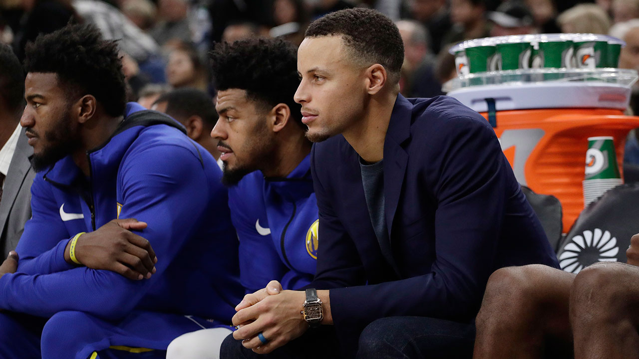 steph-curry-watches-his-team-play-from-the-bench
