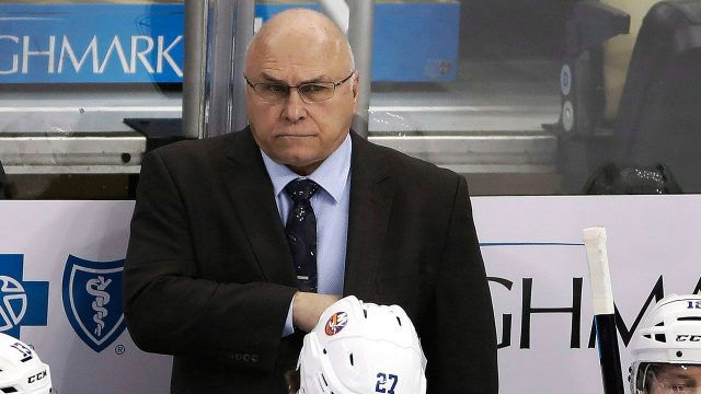 NHL-Islanders-Trotz-stands-on-bench
