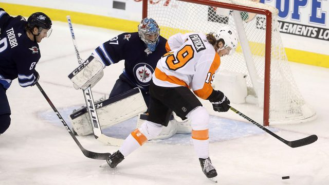 NHL-Jets-Hellebuyck-watches-puck-against-Flyers