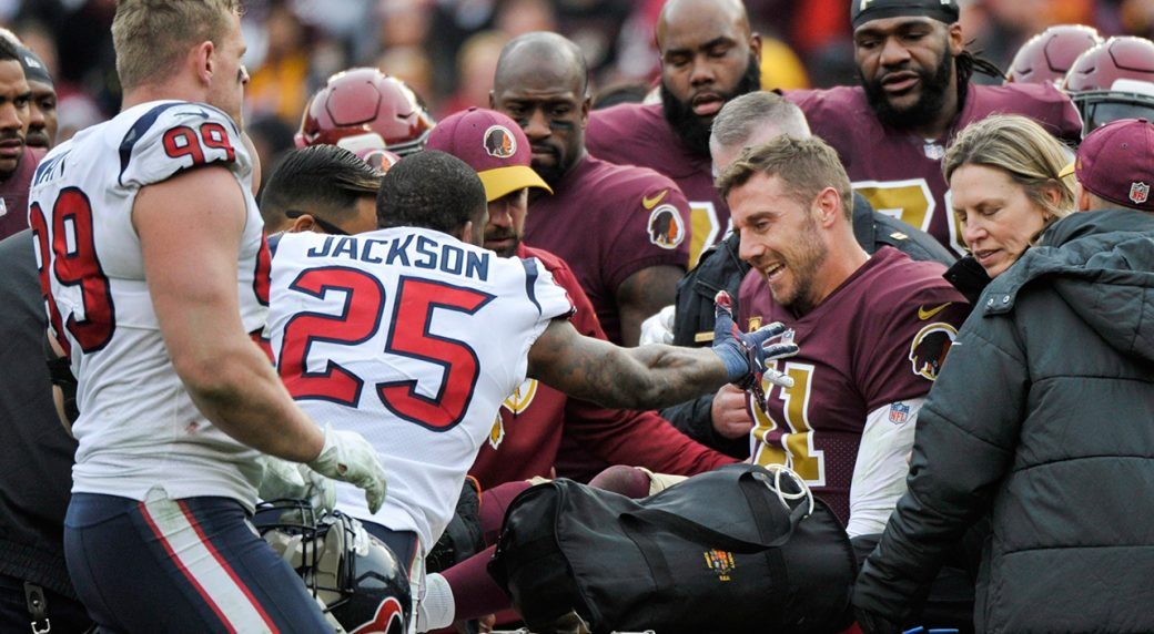 9318b443 Redskins ask for privacy amid reports of Alex Smith surgery complications.  alex-smith-is-comforted-by-texans-players-after-