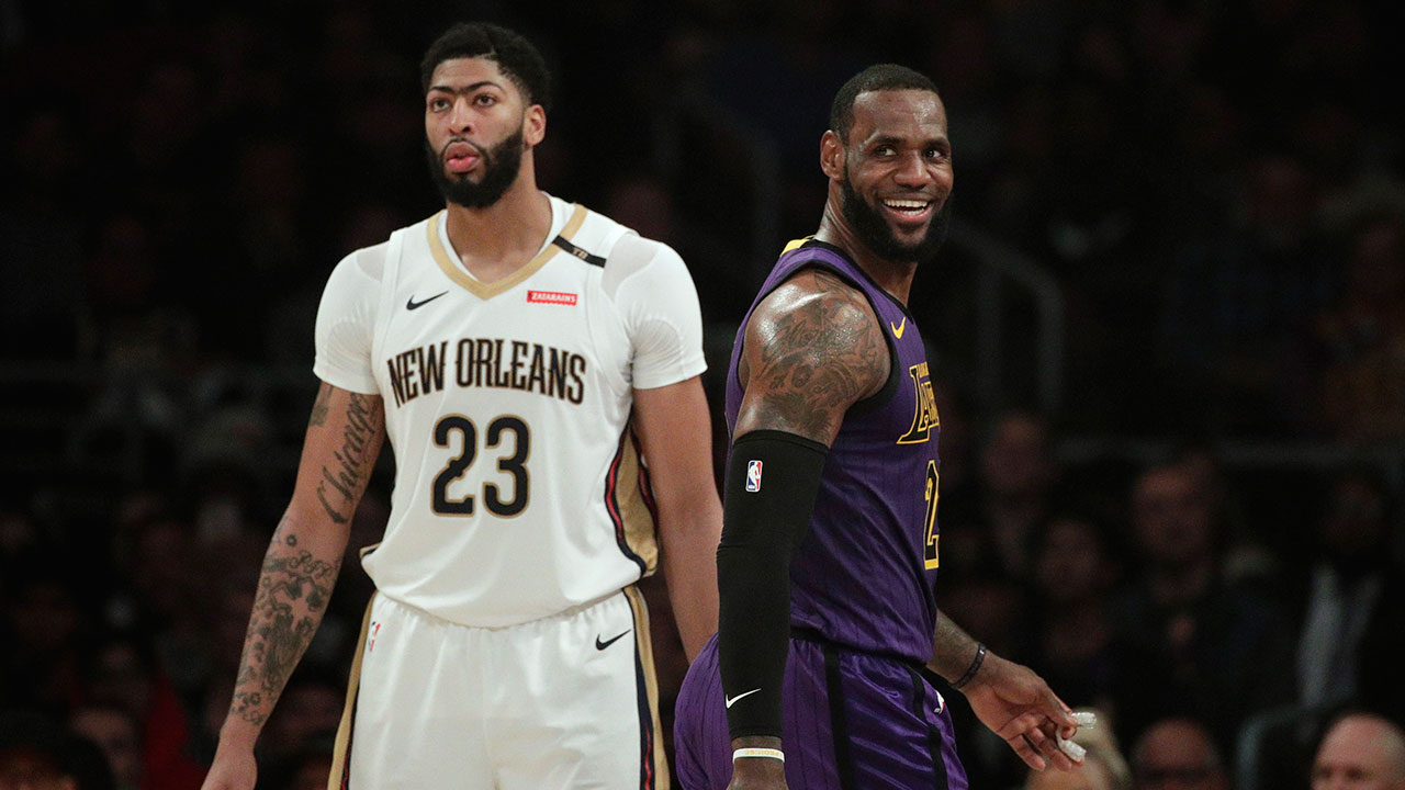 lebron-james-smiles-as-he-walks-past-anthony-davis