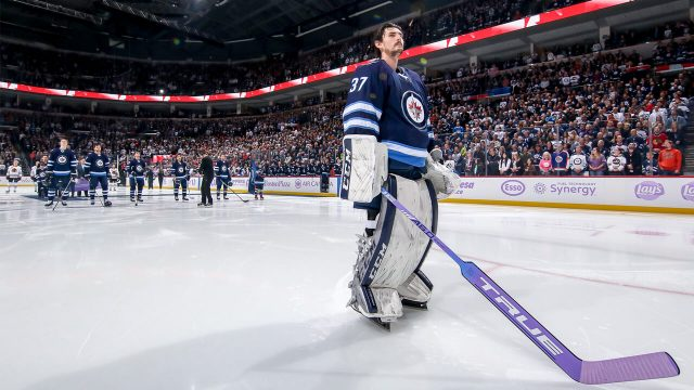 connor-hellebuyck-stands-for-O-Canada-in-Winnipeg