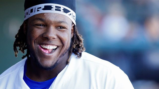 vlad-guerrero-jr-laughing-in-dugout-feature