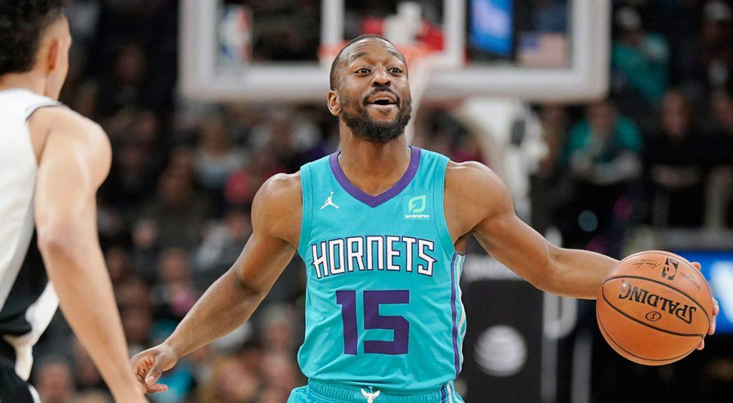 NBA-Hornets-Walker-dribbles-against-Spurs